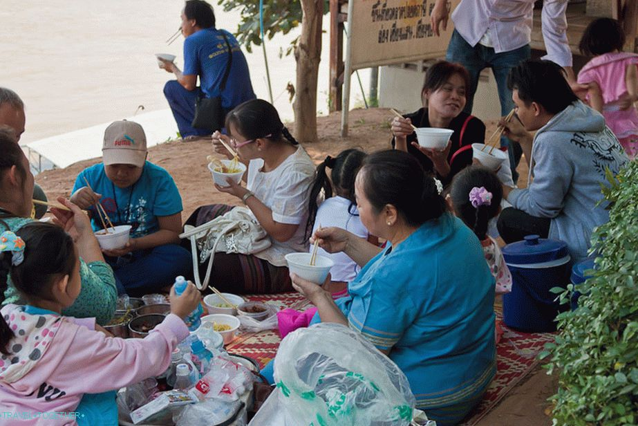The whole family at lunch on the banks of the Mekong River