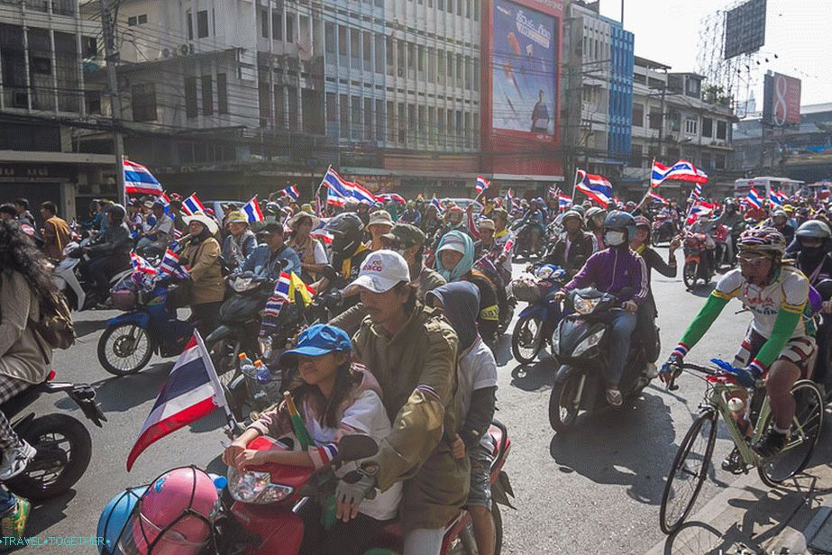With children, on bikes and bicycles, with flags and smiles on their faces