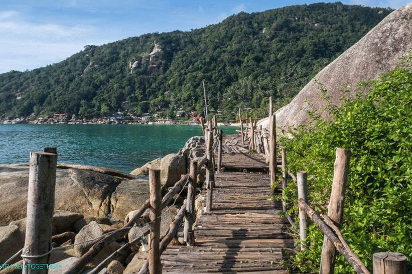 The bridge on the left side of the beach, leading from the bar Bambu Hut